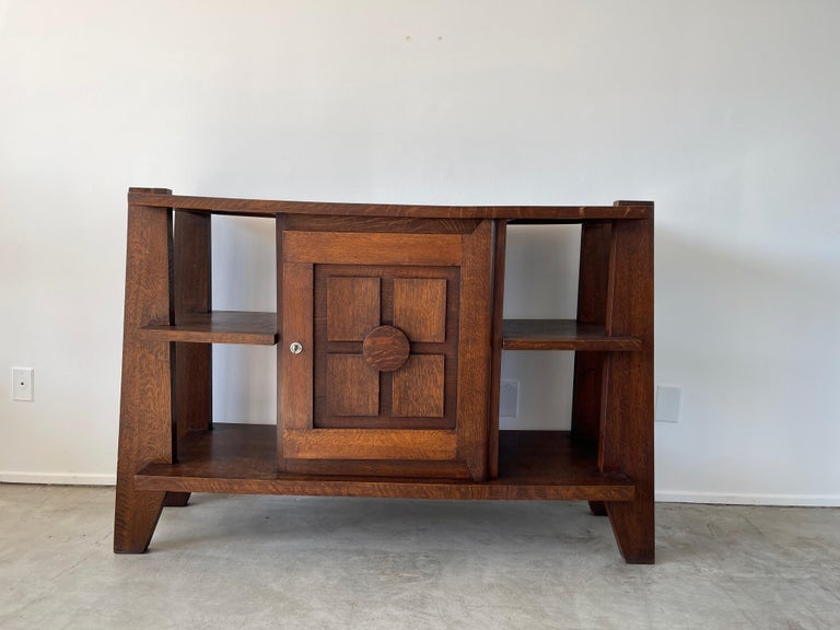Charles Dudouyt cabinet with angular legs and open shelving. Wonderful patina and function.