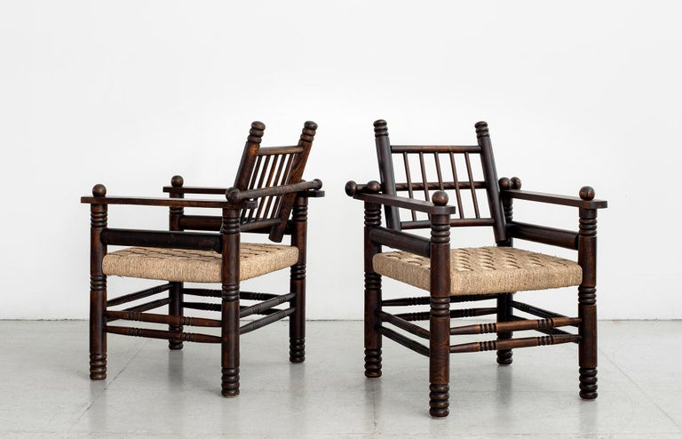 """Fantastic pair of Charles Dudouyt chairs with newly rushed seats, carved oak legs and sphere details.  Privoting back with wonderful patina to wood.   W 26 1/4"""" D 25 3/4"""" H 34 1/2"""" SH 17"""""""