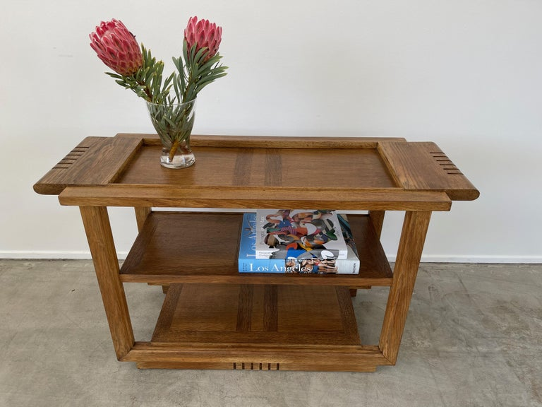 Charles Dudouyt console with signature carved detail and intricate inlay design.  Great as an entry piece of bookshelf or even a bar table!.