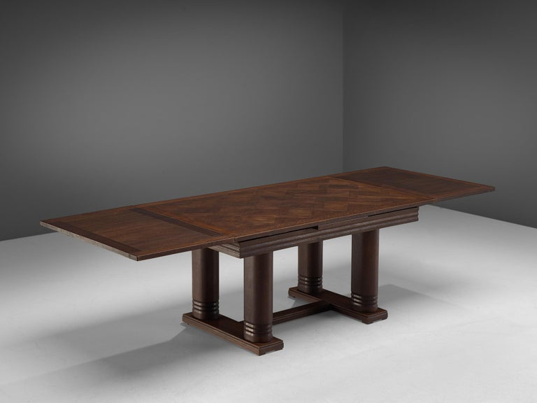 Charles Dudouyt, dining table, oak, France, 1940s.  Majestic centre table in dark brown oak. This Art Deco table shows the great craftsmanship of Charles Dudouyt. The tabletop in inlayed with different pieces of wood, creating a beautiful pattern