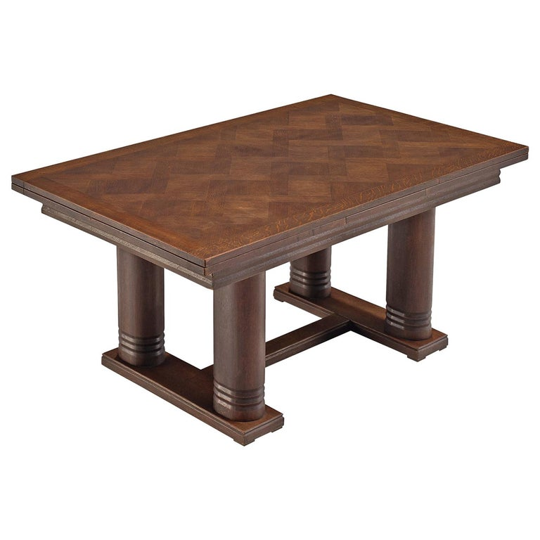 Charles Dudouyt Extendable Table in Dark Stained Oak For Sale