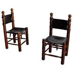 Charles Dudouyt Leather Chairs