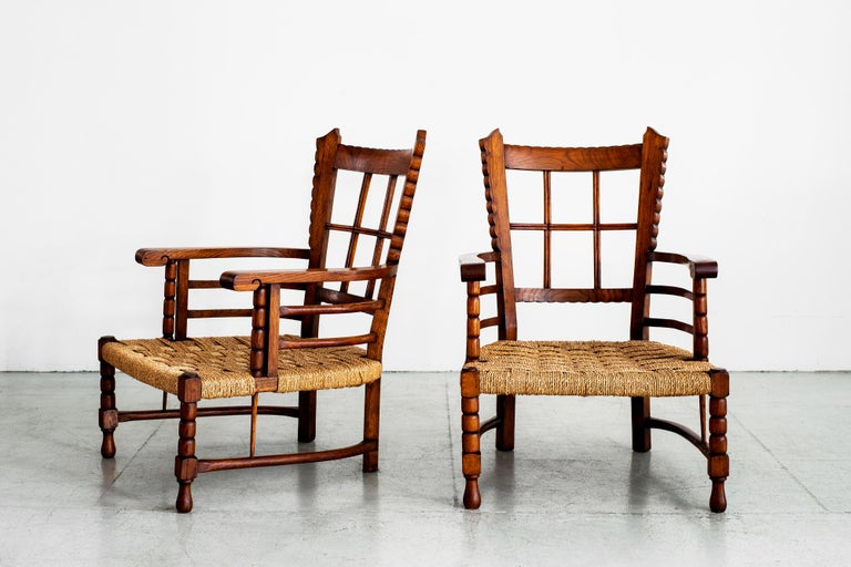 Fantastic pair of Charles Dudouyt chairs with low rushed seats and beautiful carved oak Scalloped carved edges throughout the chairs with ornate detail.
