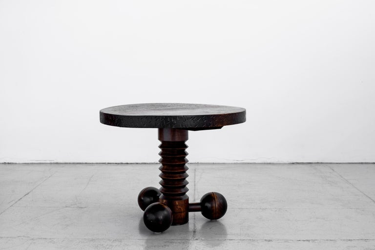 Great sculptural side table by Charles Dudouyt with three wood balled feet and carved corkscrew base, and carved top. Wonderful patina throughout.