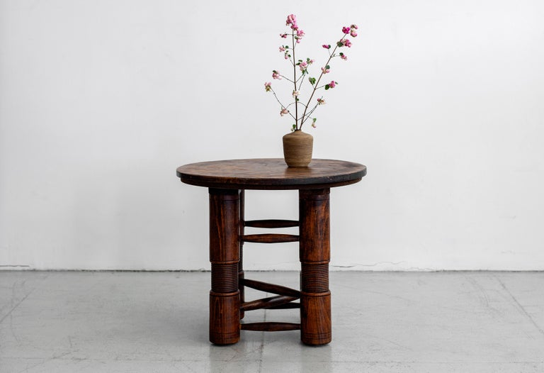 Fantastic rare side table by Charles Dudouyt with four wood cylindrical legs and carved wood detailing. Wonderful patina throughout.