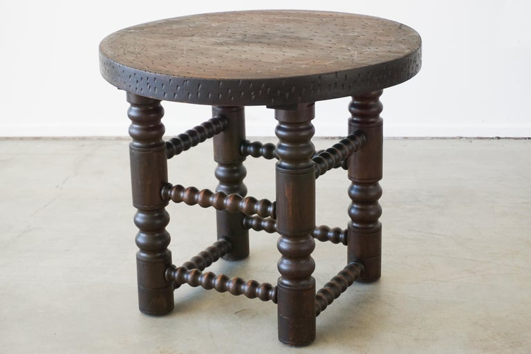 Fantastic rare side table by Charles Dudouyt with four carved wood legs and textured carved oak wood top.   Wonderful dark patina.