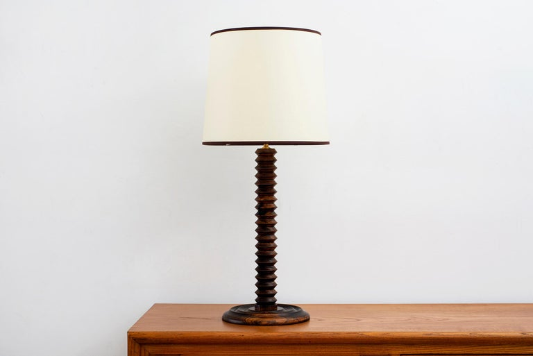 Charles Dudouyt table lamp with signature corkscrew shape -  Wonderful patina to oak Newly rewired and new shade.   Shade diameter - 14