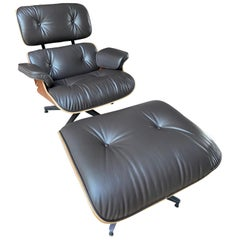 Charles Eames - Brown Lounge Chair and Ottoman-Herman Miller, 2011