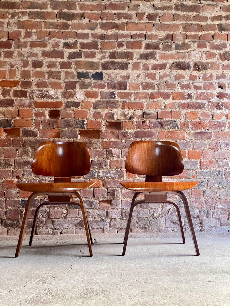 Charles Eames DCW dining chairs by Herman Miller, circa 1950 Rare early pair of DCW chairs, designed by Charles and Ray Eames for Herman Miller in 1946, labelled 'Charles Eames design Herman Miller Zeeland Michigan, circa 1950. Original Herman