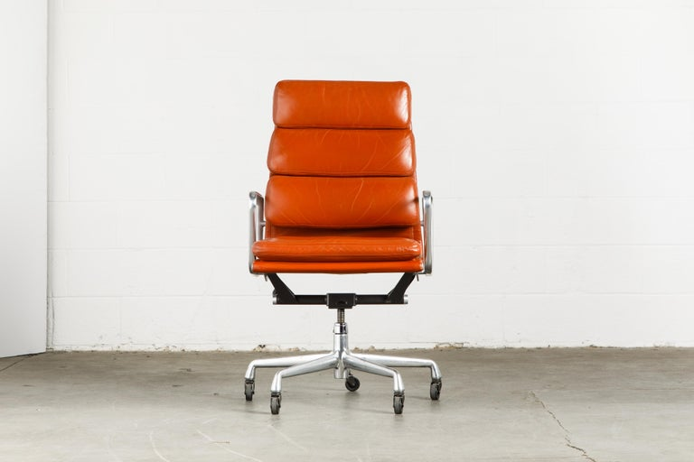 Incredible leather on these six Charles and Ray Eames for Herman Miller high-back 'Soft Pad' executive desk chairs. The light patina and aging to the cognac color leather provides a soft patina that is attractive and adds greater complexity to the