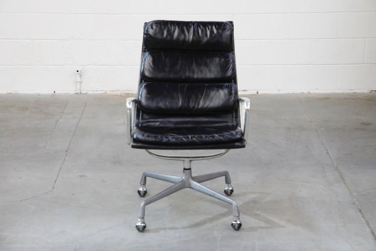Incredible black leather on this set of five (5) early year production, very collectible, Charles and Ray Eames for Herman Miller high-back executive soft pad swivel lounge chairs. The light aging to the leather provides a soft patina that is so