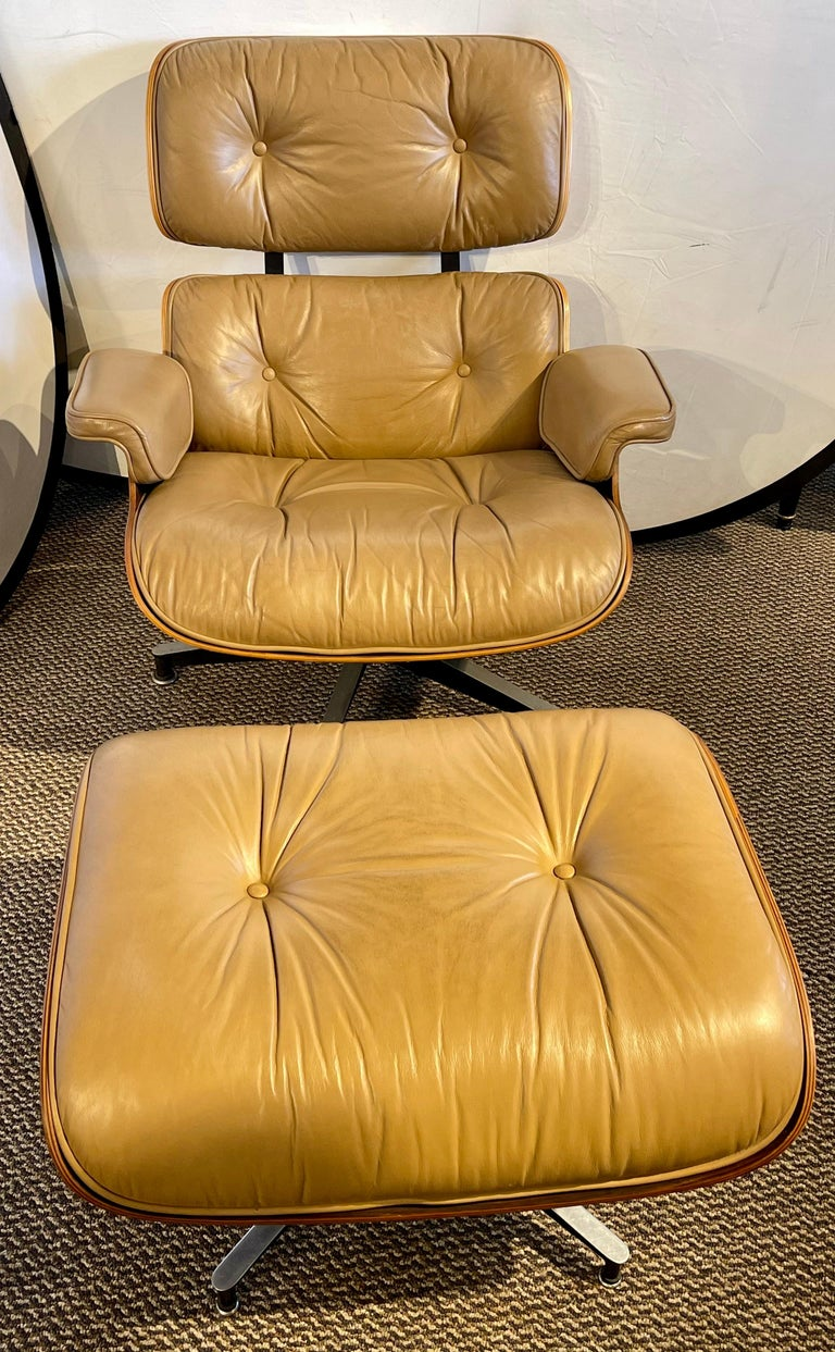 Charles Eames, Herman Miller Mid-Century Modern chair & ottoman. A stunning example of Eames Miller style and grace from the Mid-Century Modern era. This rosewood framed chair has its original leather upholstery that is so slightly worn that it is