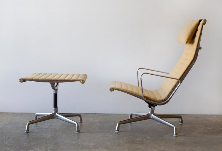 All original Charles Eames Aluminum Group lounge chair and ottoman produced by Herman Miller. This example was manufactured in the 1970s and was owned by an executive who worked for Herman Miller. Upholstered in the seldom-seen camel-colored felted