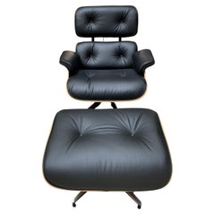 Charles Eames, Lounge Chair and Its Black Leather and Rosewood Ottoman, 2011