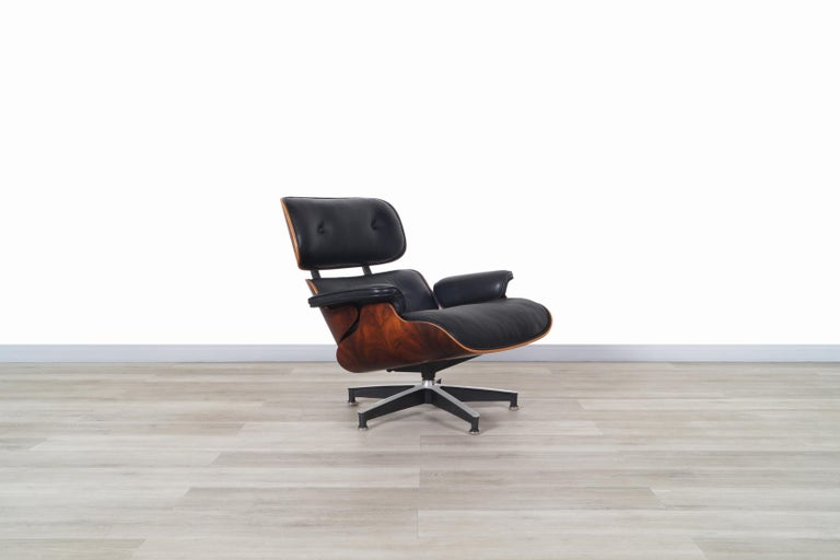 Late 20th Century Charles Eames Rosewood Lounge Chair and Ottoman by Herman Miller