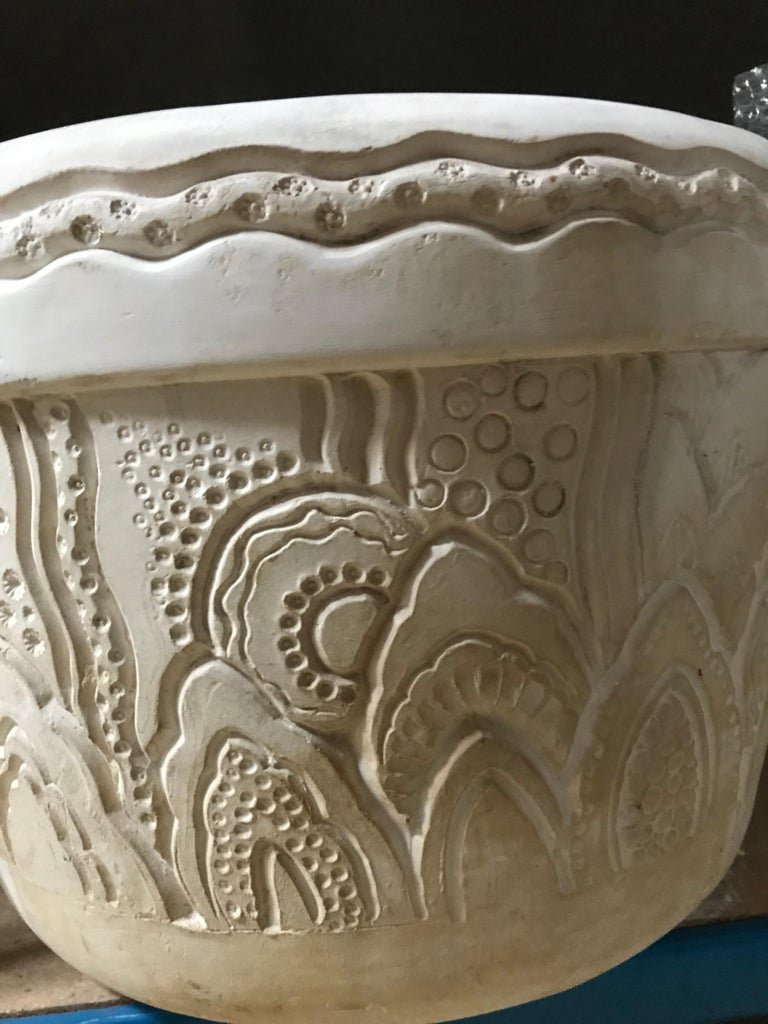 Rare pair of two magnificent large flower-pots in plaster with a engraved decor of bubbles, seaweeds and stylized waves. (Stains and loss). Signed on the side.  Provenance :  - Château de Larnagol - Collection Raymond Subes