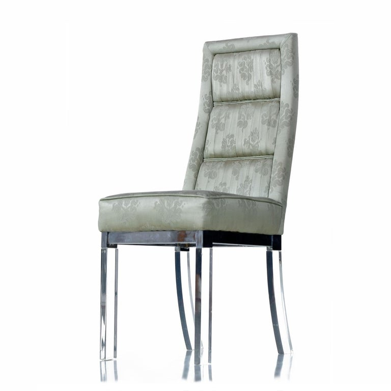 Mid-Century Modern chrome and Lucite acrylic high back dining chairs. The design made famous by Charles Hollis Jones exudes luxury. Elegantly pleated floral print celadon green tempered by the futuristic gleaming chrome and Lucite. The chairs are