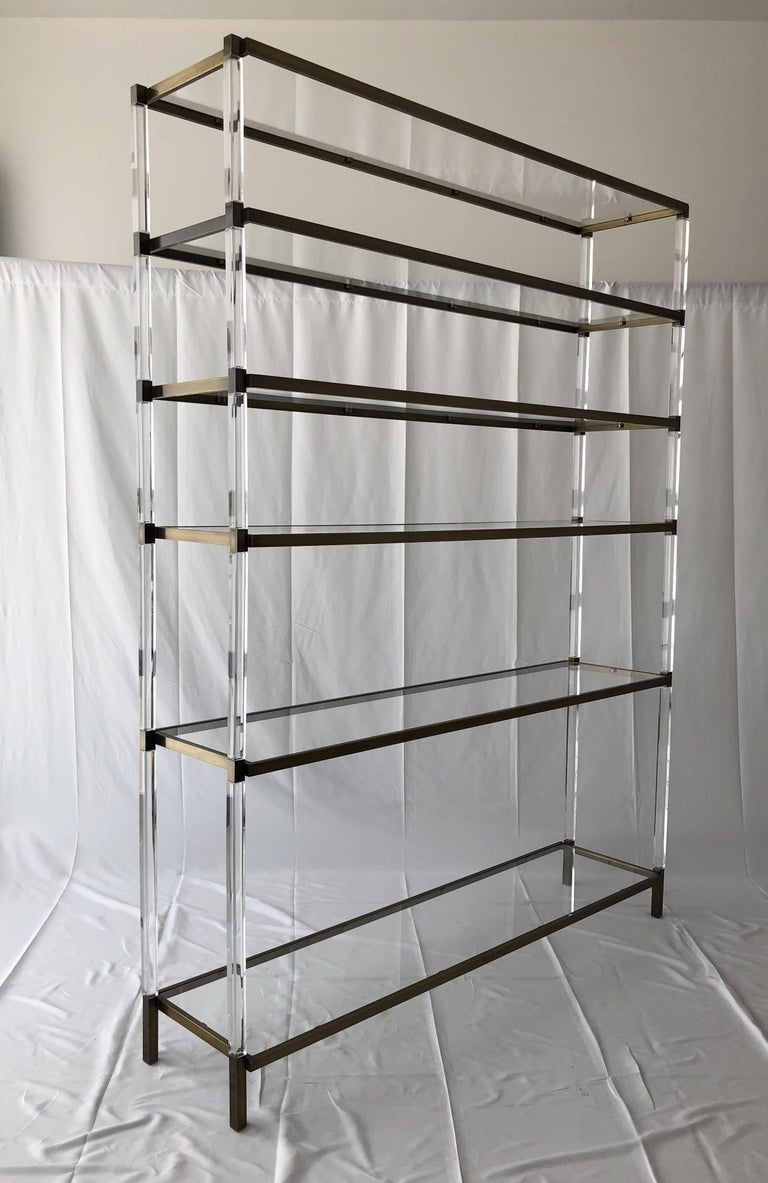 Stunning Lucite and brass étagère/shelving unit designed and manufactured by Charles Hollis Jones.