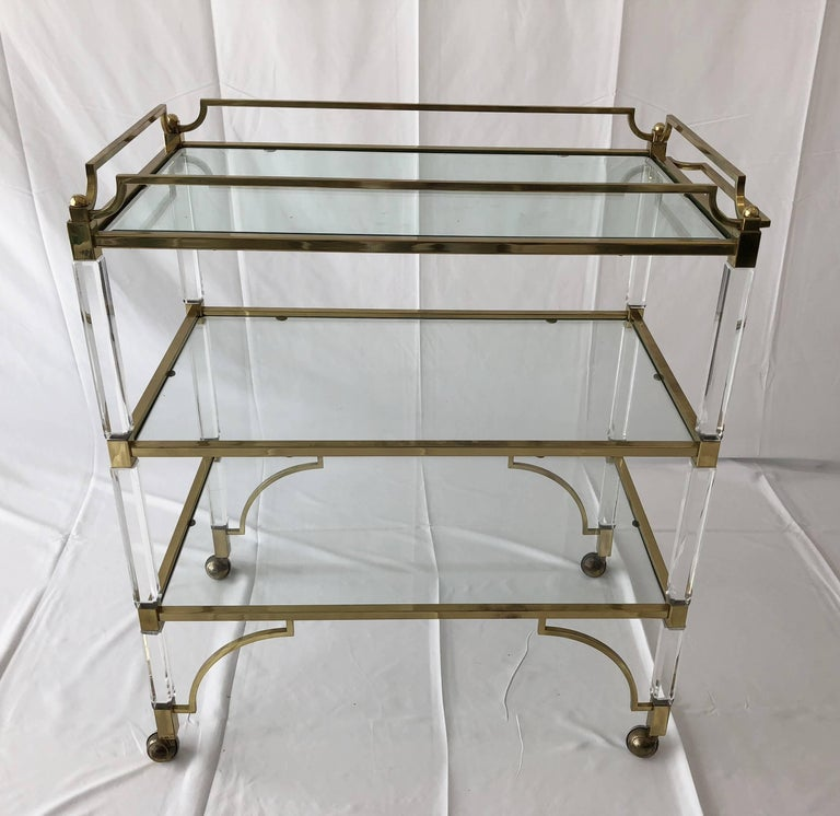 Beautiful and rare Lucite and brass serving/bar cart designed by Charles Hollis Jones and manufactured by Swedlow in the early 1960s, this piece is part of the