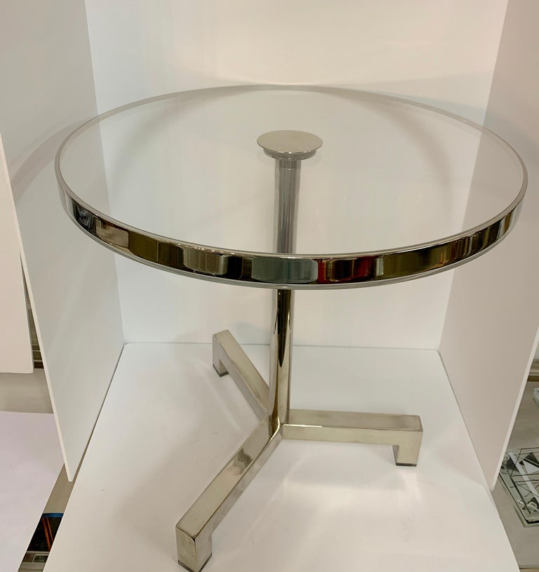 A nicely designed side table by Charles Hollis Jones. Purchased from Mr. Jones. It is a vintage table that has a new top and has been polished and cleaned up. The legs feature Lucite feet. There is a band of nickel around the edge. A nice design.