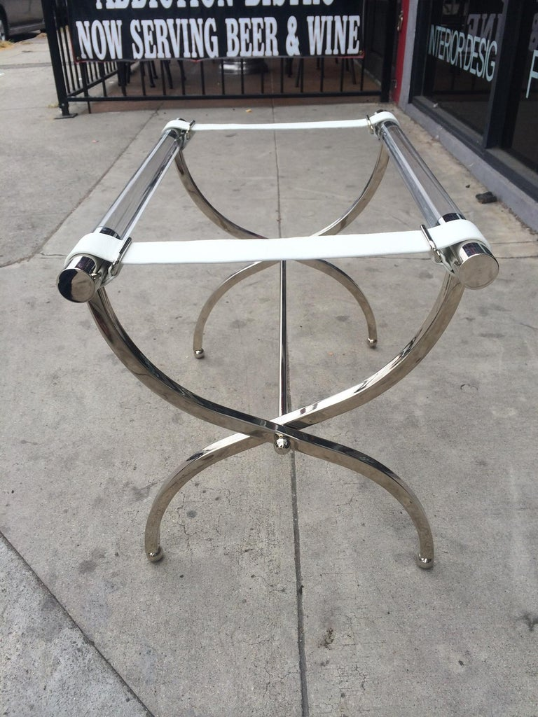 Stunning luggage rack designed by Charles Hollis Jones in the 1960s.  The rack is beautifully designed and in excellent original condition, the combination of materials used in this pieces works perfectly.  Measurements: 28