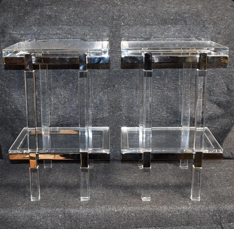Two tiers lucite and polished nickel-plated end tables made and signed by Charles Hollis Jones. Provenance directly from artist private collection.