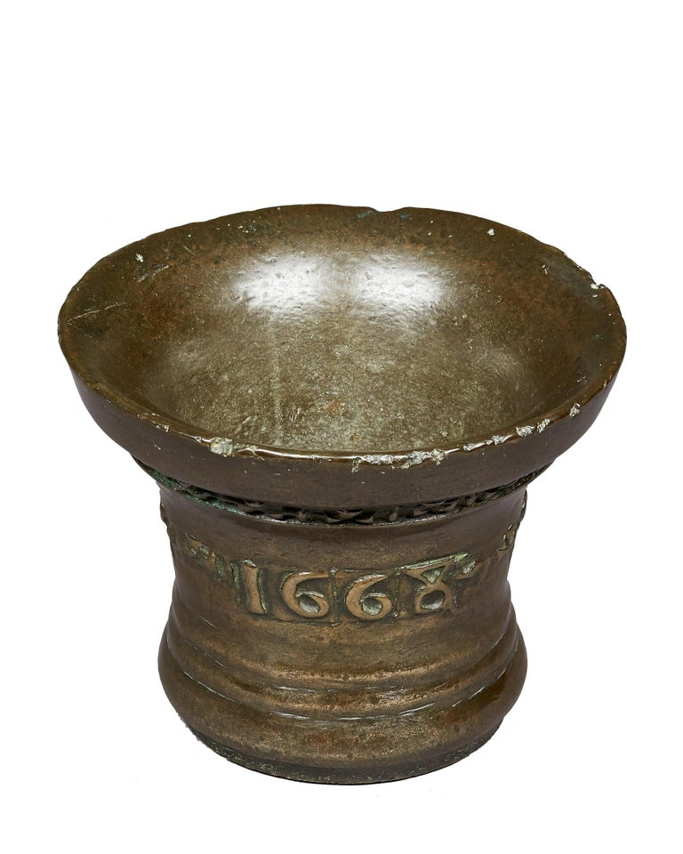 Charles II Lead Bronze Mortar, by 'Anthony Bartlet', English, Whitechapel, London, dated 1668.   The deep rim Mortar cast with interlaced crosses beneath the lip, the body further cast with scrolling cross design and dated 1668. With contemporary