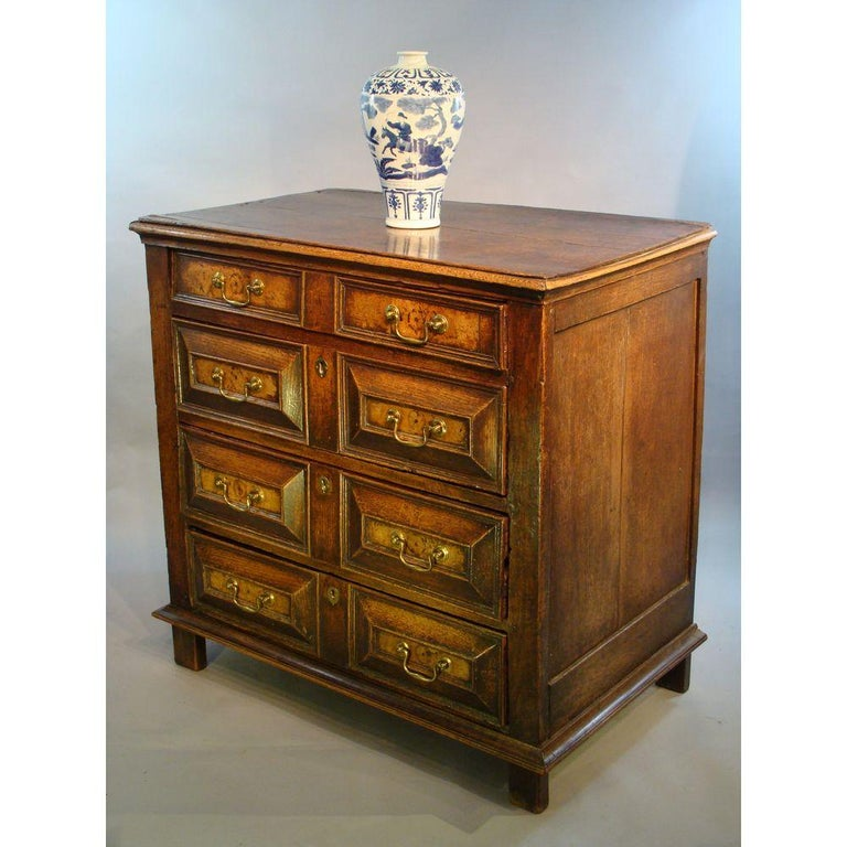 Charles II period (1630-1685) oak and walnut chest of drawers, or commode.  Retaining an old waxed surface of very good rich color and patination.  With typical geometric drawer fronts and side runners, confirming a late 17th century date of circa