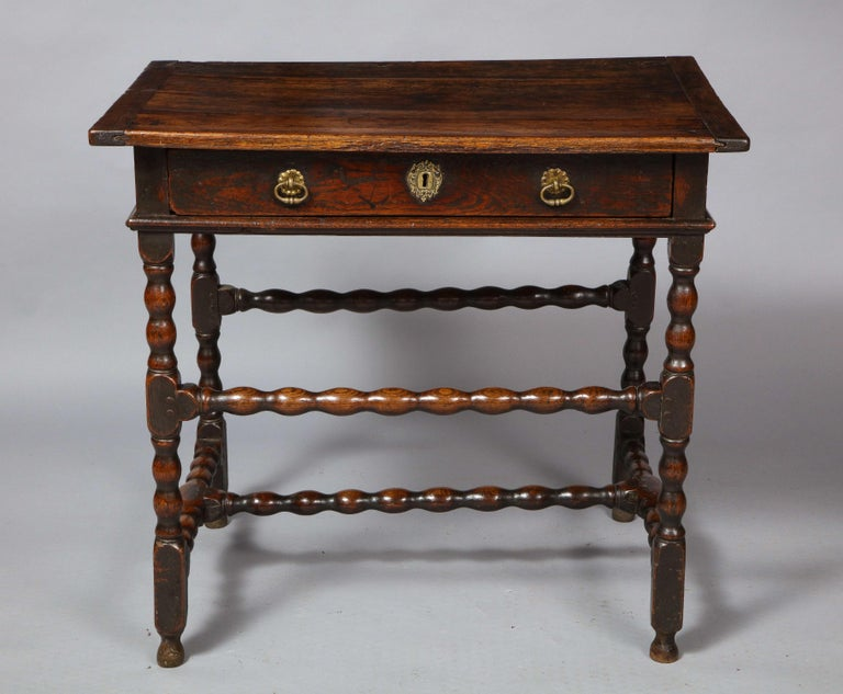Fine Charles II period oak side table, the top with breadboard ends over single drawer over molded apron, the sausage turned legs with desirable high and low cross stretchers and standing on original turned feet, the whole possessing good rich color