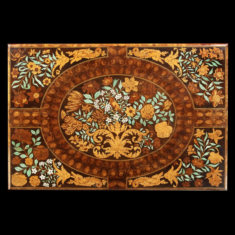 Charles II olive oyster floral marquetry table, attributed to Gerrit Jensen in Association with Gole.  This accomplished Charles II marquetry table clearly bears the influence of Dutch and French masters of marquetry working in the last quarter of