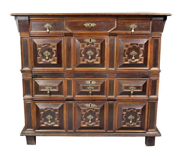 In two parts, rectangular top over a thin drawer and panelled deep drawer, lower section with two panelled drawers, stile feet. Provenance; Sothebys, Vernay & Jussel.