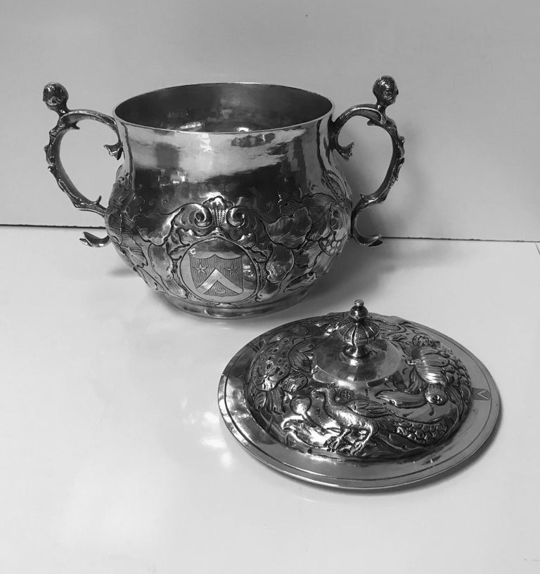 Charles II silver caudle cup with cover, London, 1663: 6 inches height to the top of the finial and fully hallmarked for London 1663 on the bowl and under the rim of the cover and top of cover; maker's mark TA mullet and pellets below, figural