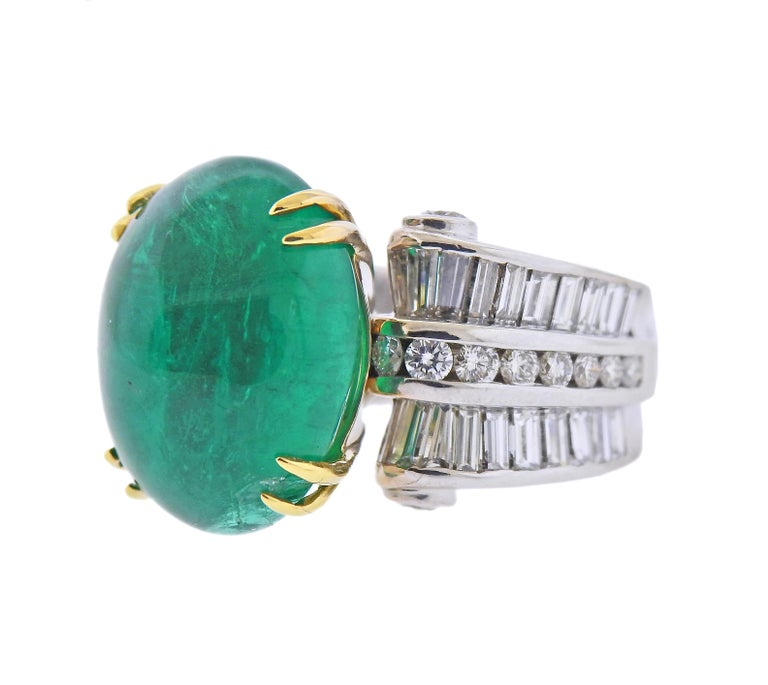 18k gold ring by Charles Krypell, with center approx. 20ct emerald cabochon (has chip under one prong) , measuring 17.1 x 13.4 x 9.8mm, surrounded with approx. 1.50ctw in diamonds. Ring size - 6.5, ring top is 17mm wide. Marked: Krypell 750. Weight
