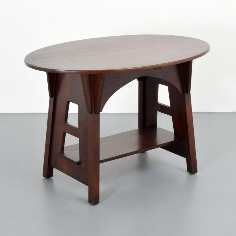 Two-tier form table with cut-outs and corbel by Charles Limbert.  Markings: Limberts stamp.
