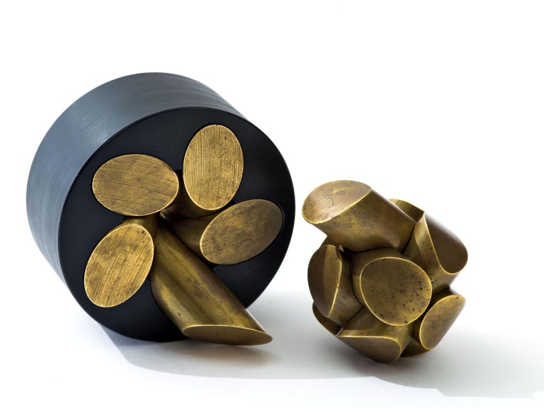 Ball Puzzle in brass, designed in 1967, and Zen Puzzle in brass and Delrin, 1987, designed by sculptor, Charles O. Perry. Ball puzzle comes with its original felt case and instructions. Both show wonderful, heavy patina and each are engraved on one