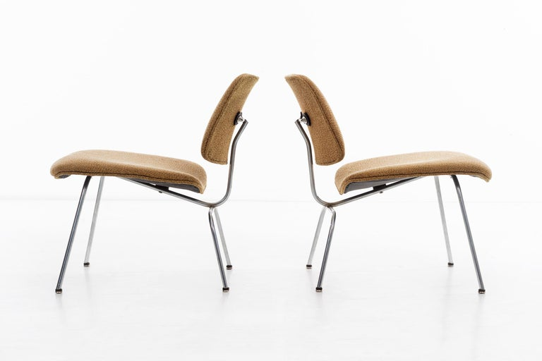 Eames for Herman Miller, rare upholstered LCM's original factory upholstery with tacks on underside. Few of these were ordered and were usually custom.