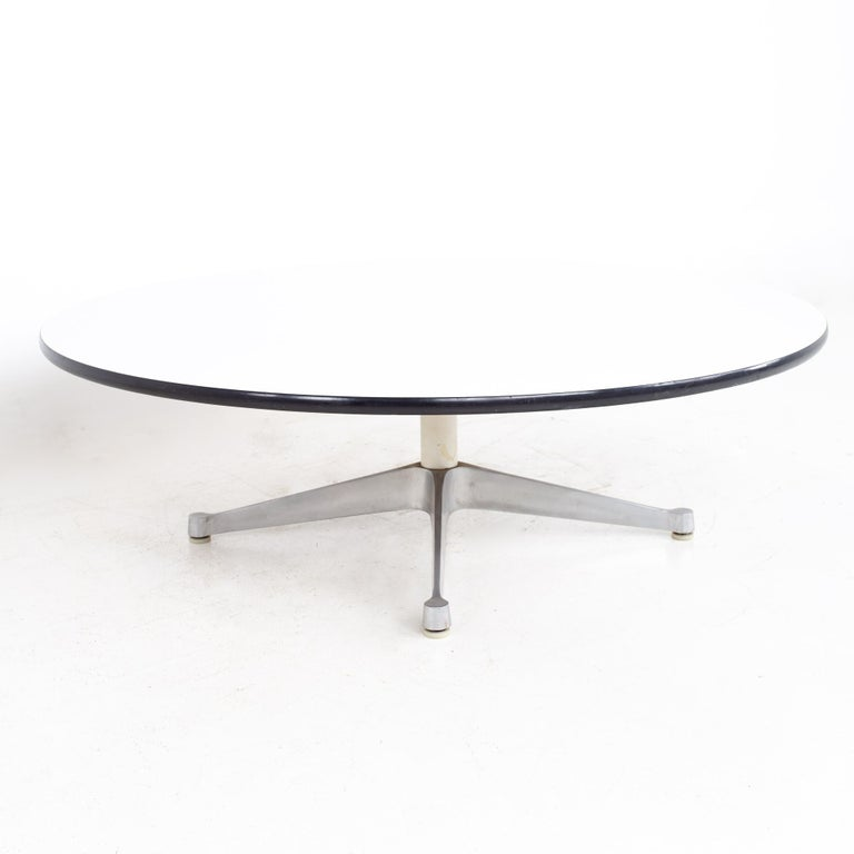 Charles and Ray Eames for Herman Miller Aluminum Group mid century round laminate and stainless coffee table. Coffee table measures: 47.5 wide x 47.5 deep x 15.5 inches high  All pieces of furniture can be had in what we call restored vintage