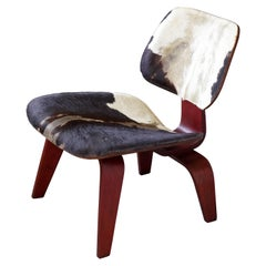 Charles & Ray Eames, Rare & Early LCW, Aniline Red Plywood, Cowhide, USA, 1940s