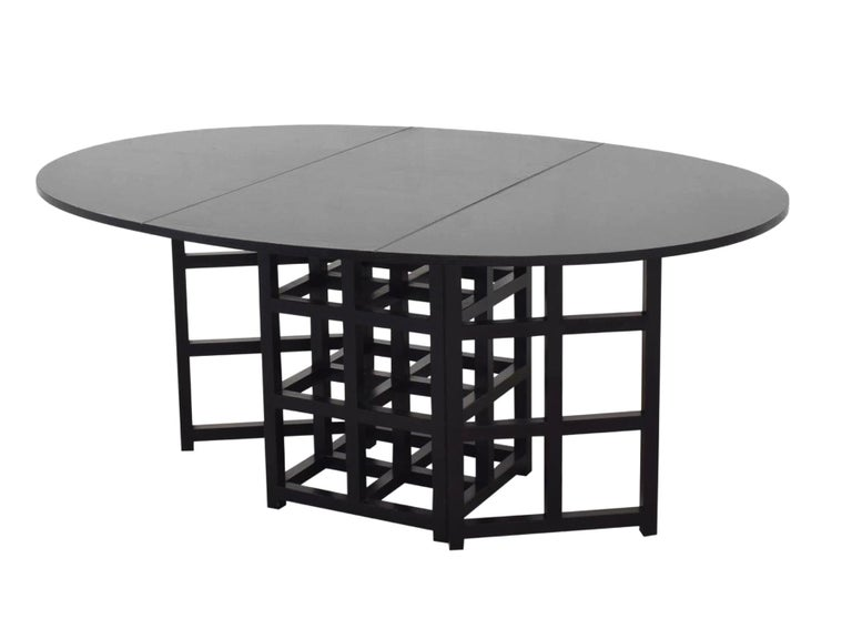 Charles Rennie Mackintosh ebonized ash folding oval table DS.1 Alivar, 1970s Prestigious, oval table in black colored ash with two hinged, folding sides, model: 322 D.S.1, a design by the Scottish designer Charles Rennie Mackintosh dating from 1918,