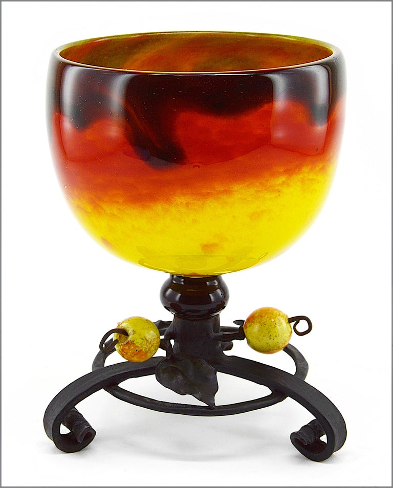 French Art Deco vase by Charles Schneider Epinay-sur-Seine (Paris), 1914-1918. Unusual vase colored with bright yellow and rich orange colors overlaid with a veil of dark brown/black. Wrought-iron base made by Schneider in a workshop of the factory