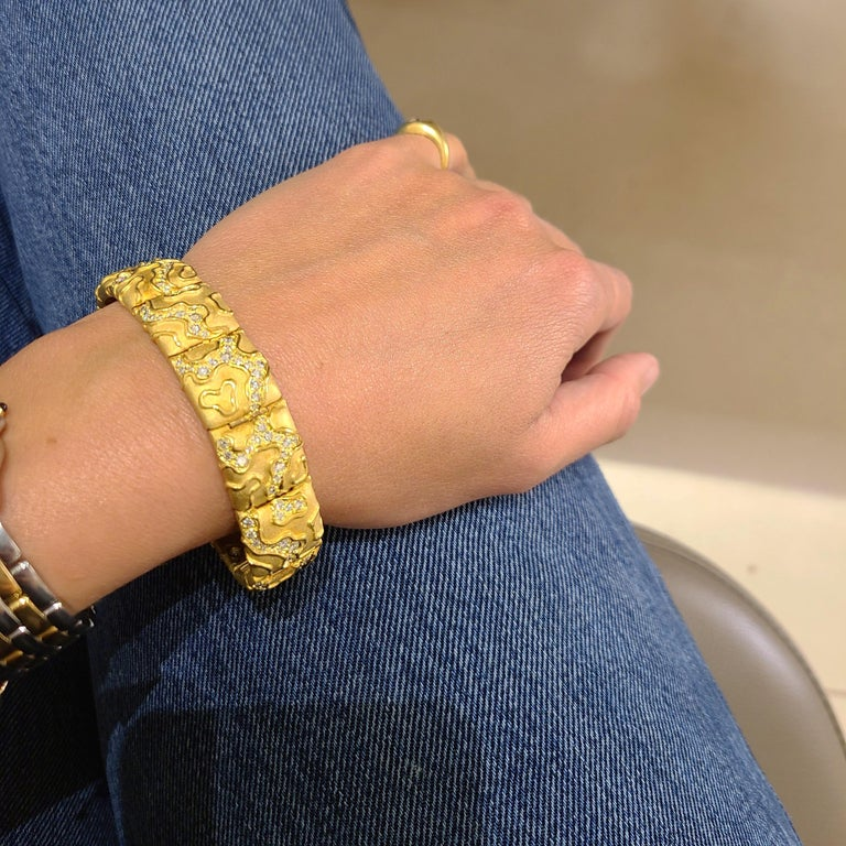 Designed by the legendary Charles Turi Jewelry Company. This bracelet is composed of 12 satin finished