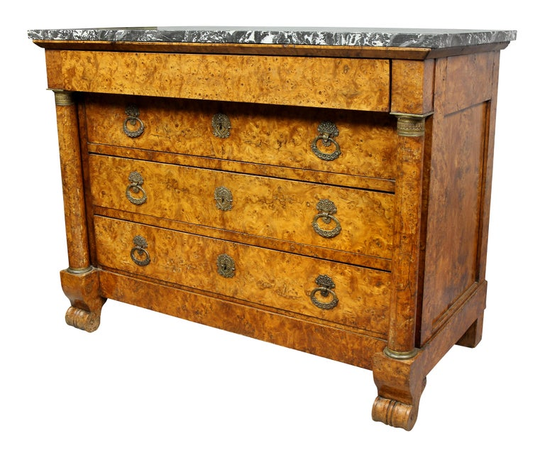 With a rectangular St Anne gray marble top over a frieze drawer over three graduated drawers flanked by columns, scroll feet. Original bronze handles.