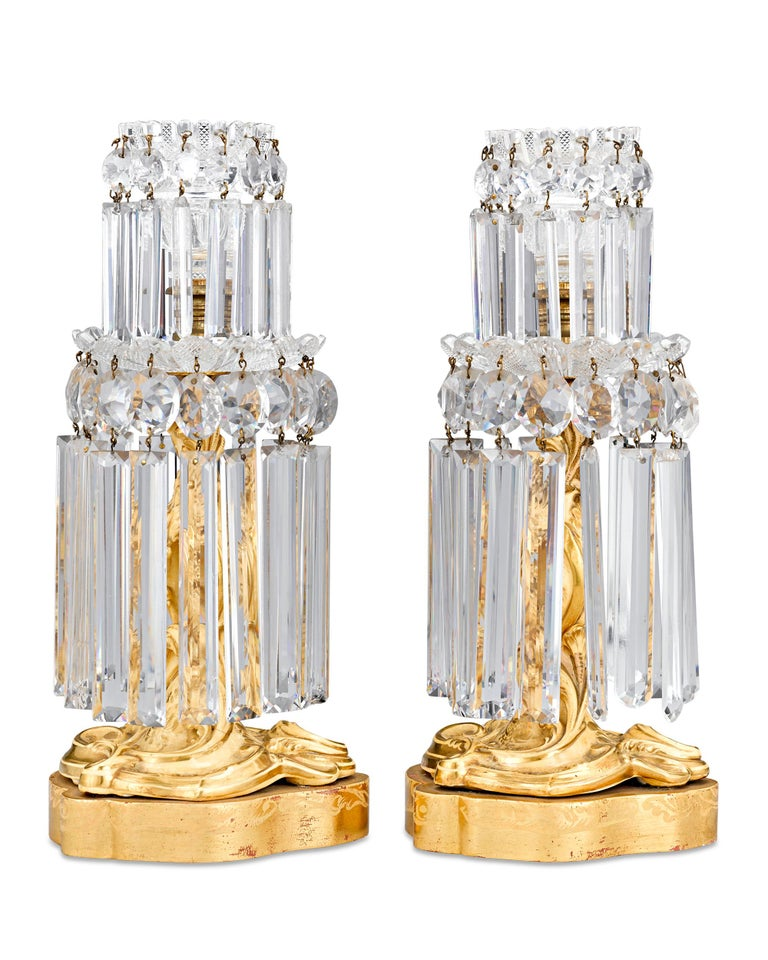 This rare pair of French crystal lusters dates to the Charles X period and embodies the extraordinary artistry achieved during this brief era. The ornately cut prisms beautifully capture the light, creating a gorgeous effect as they cast a warm glow