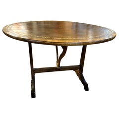 Charles X French Provincial Tooled Leather Tilt-Top Walnut and Oak Wine Table