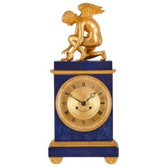 Charles X Lapis and Gilt Bronze Mantel Clock
