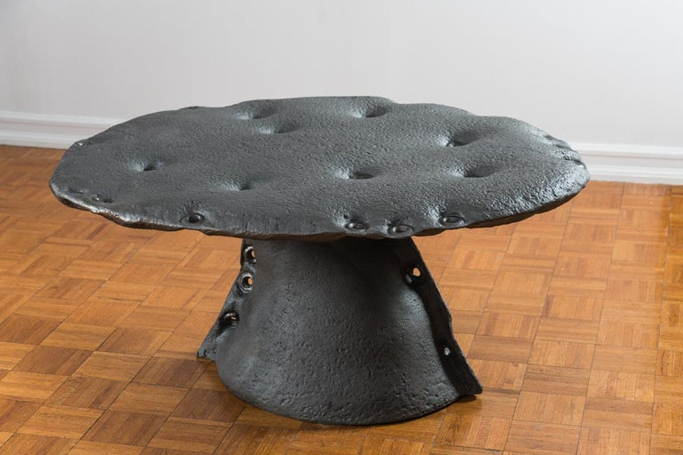 This work is a cast iron tall coffee or center table. There is lots of room for customization as it can be poured out in aluminium or bronze and go up to 28