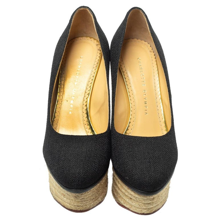 Well, isn't this Charlotte Olympia pair simply stunning! The pumps have been designed so beautifully with raffia in a black hue that they make one's heart flutter. They come in a simple design of espadrille platform wedges, which gives the pair full