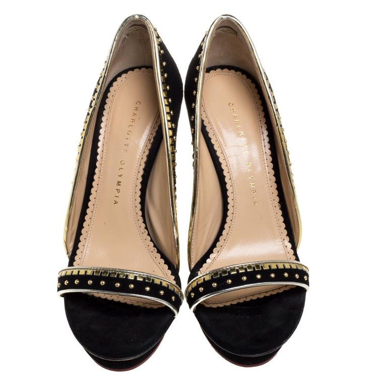 Introduce your shoe closet to an addition as magnificent as this pair of pumps from Charlotte Olympia! These black pumps have been artistically crafted from suede and designed with details such as open toes and 12 cm gorgeous heels. The metallic