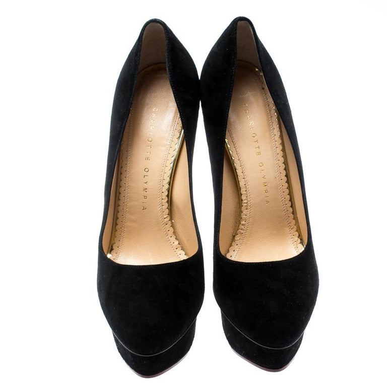 Own this meticulously designed pair of Charlotte Olympia pumps today and dazzle everyone whenever you step out! Crafted out of suede and lined with leather on the insoles, this creation is from their Dolly collection. They have been beautified with