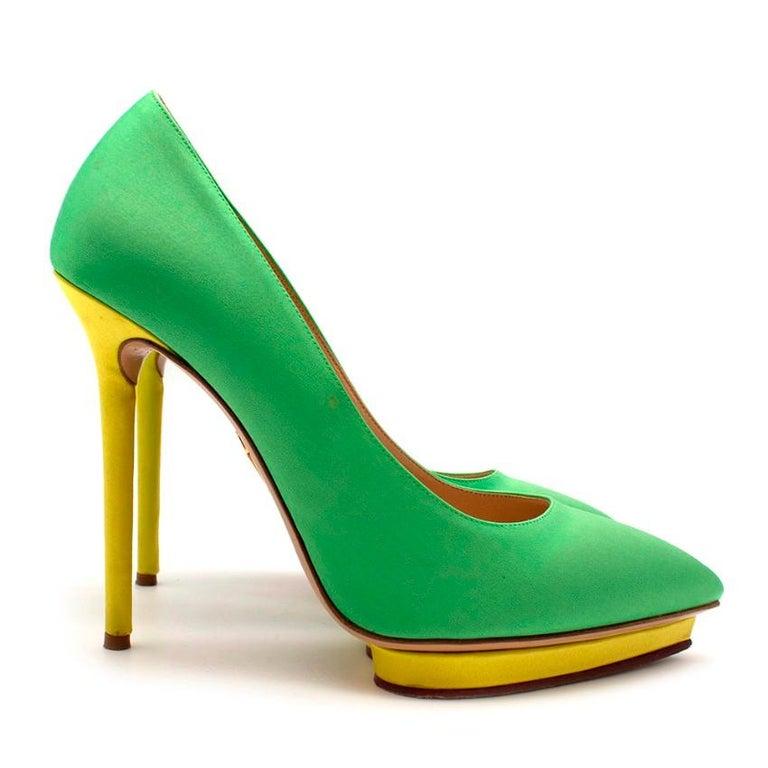 Charlotte Olympia Green Neon Satin Heart Platform Heels   - Pumps  - Nude sole - Heart shaped platform with satin neon yellow edging - Neon yellow heel   Materials: - Satin  Made in Italy   Heel height - 13cm Platform height - 2cm Insole -
